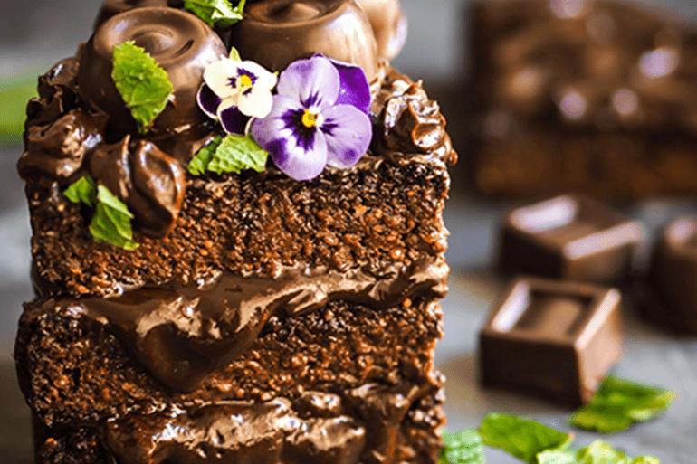 egg free chocolate cake garnish with chocolates and flowers